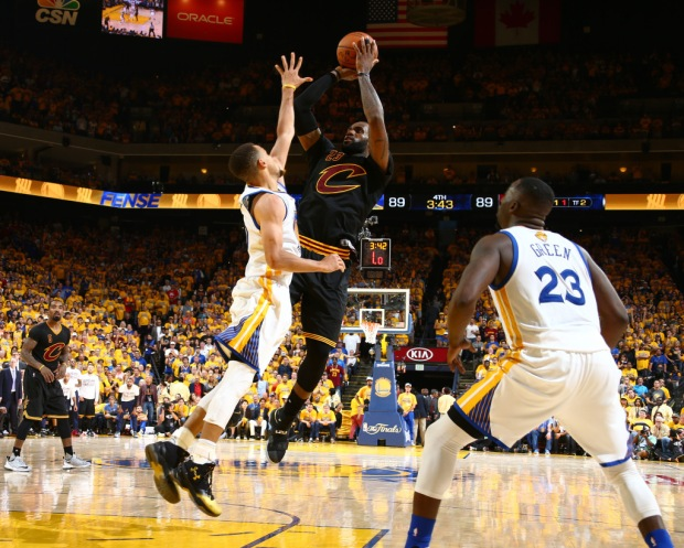 OAKLAND, CA - JUNE 19:  LeBron James #23 of the Cleveland Cavaliers shoots against Stephen Curry #30 of the Golden State Warriors in Game Seven of the 2016 NBA Finals on June 19, 2016 at Oracle Arena in Oakland, California. NOTE TO USER: User expressly acknowledges and agrees that, by downloading and or using this photograph, user is consenting to the terms and conditions of Getty Images License Agreement. Mandatory Copyright Notice: Copyright 2016 NBAE (Photo by Nathaniel S. Butler/NBAE via Getty Images)